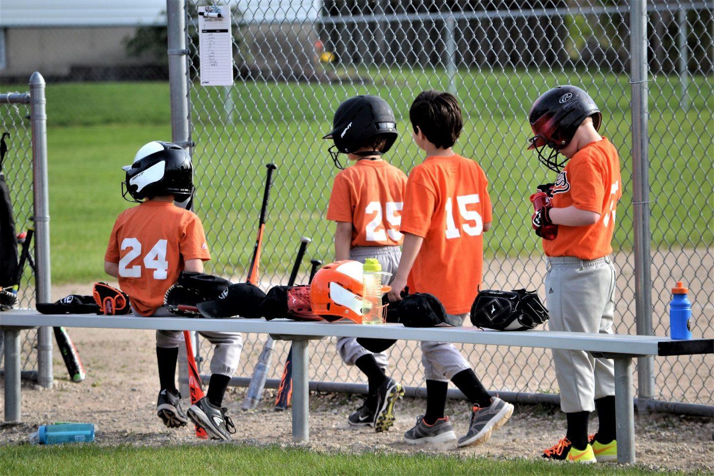 little league team getting ready to bat