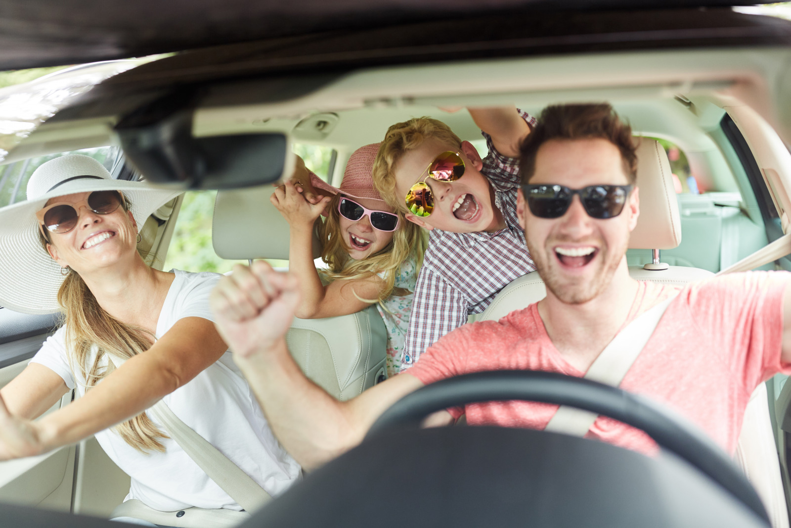 family in their new car loving life happy and cheering